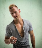 Fit Male Model Smiling And Pointing Finger To Camera