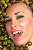 happy beautiful female face in the gooseberry