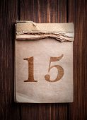 picture of 15 year old  - Old calendar with digit on a wooden background - JPG