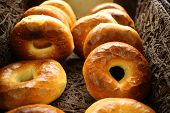 picture of bagel  - Basket full of  bagels with shallow dept of field - JPG