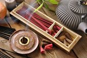 picture of buddha  - VARIOUS TYPES OF INCENSE WITH TEAPOT AND BUDDHA STATUE - JPG