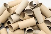 stock photo of toilet  - Empty Toilet Rolls Stack Up On a Black Background - JPG