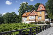 image of public housing  - Traditional wooden house in Kuressaare town on Saaremaa island in Estonia - JPG