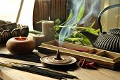 foto of typing  - VARIOUS TYPES OF INCENSE WITH TEAPOT AND BUDDHA STATUE - JPG