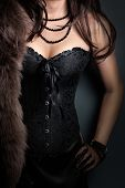 stock photo of corset  - woman wearing corset and fur in retro style - JPG
