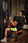 stock photo of lats  - Young man doing lats pull - JPG