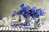 stock photo of crockery  - Still life with a bouquet of blue tones and white crockery - JPG