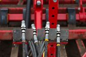 pic of hydraulics  - Landscape format image of four hydraulic couplings - JPG
