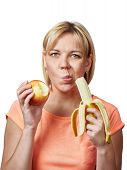 image of snatch  - Happy and healthy woman with banana and apple isolated - JPG
