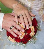 foto of wedding feast  - Wedding bouquet hands of bride and groom - JPG