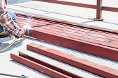 picture of welding  - an man welding the iron bars together - JPG