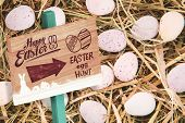 image of easter candy  - Easter egg hunt sign against little candy easter eggs on straw - JPG