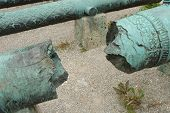 foto of cannon  - Broken antique ornamented cannon barrel  - JPG