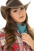 pic of cowgirls  - a cowgirl looking to the side holding on to her bandana - JPG
