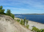 foto of pontoon boat  - View of the city beach of the Volga River in the city of Volgograd - JPG