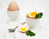 stock photo of boil  - boiled eggs for breakfast on a old wooden table - JPG