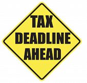 stock photo of warning-signs  - Tax Deadline Ahead warning sign with black letters over a yellow background - JPG