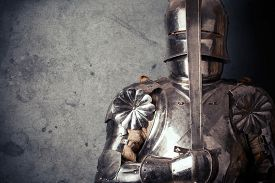 picture of sword  - knight wearing armor and holding two - JPG