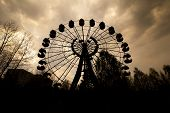 pic of ferris-wheel  - Silhouette of the abandoned Ferris wheel in the amusement park in Pripyat - JPG