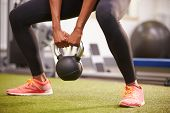 image of section  - Woman exercising with a kettlebell weight - JPG