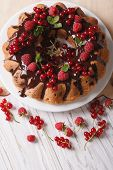 image of sponge-cake  - Fragrant sponge cake with fresh berries and chocolate glaze on a plate close - JPG
