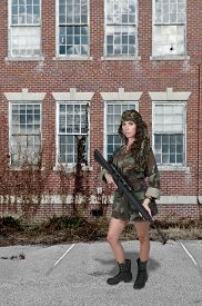 stock photo of m16  - Beautiful young woman soldier with a M16 rifle - JPG