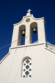 picture of blue-bell  - Ropes attached to the bells of a bell tower in front of the blue sky of a church in Santorini Greece