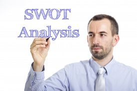 image of swot analysis  - SWOT Analysis Young businessman writing blue text on transparent surface - JPG