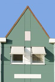 stock photo of gable-roof  - A Dutch house with a triangular gable roof gutters and sunscreen - JPG