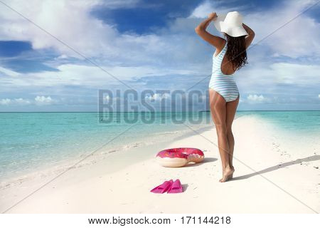 poster of White sand tropical beach and woman wearing hat and swimsuit. Summer fun travel holiday concept