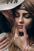Stylish Hipster Couple Portrait. Boho Gypsy Woman And Man In Hat Embracing Her Lips Closeup. Atmosph poster