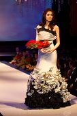 A model displays a dress by Melvin Lam