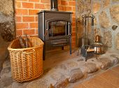 picture of cozy hearth  - View of a cozy old fireplace in the living room - JPG