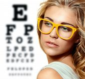 Eye Test Chart And Woman In Glasses