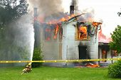 foto of firehouse  - Two Firemen Trying to Put out a House Fire - JPG