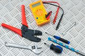 Electricians Tools And Equipment On Metal Checker Plate poster
