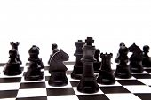 image of chess piece  - Black chess pieces on board - JPG