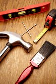 Tools on wooden panel