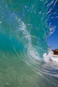 Sunny Wave Breaks on Sand