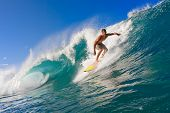 Surfer Rides a Large Blue Tropical Wave in Paradise