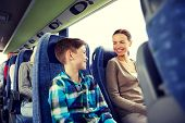 travel, tourism, family, technology and people concept - happy mother and son riding in travel bus poster
