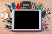 Tablet Pc Over School Supplies Or Office Supplies On School Table. Background With School Or Office poster