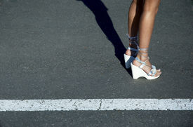 stock photo of streetwalkers  - sexy legs in sandals - JPG
