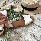 White Sandals On A Wooden Background poster