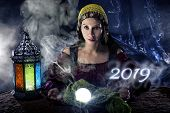 Female Fortune Teller Or Psychic Reading With A Cystal Ball Predicting The Future Of The Year 2019 poster