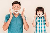 Young Father Teaches Little Son To Shave At Home. Foam On Face. Shaving Tool. Razor With Blade. Happ poster