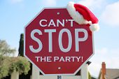 Stop Sign. Red Stop Sign with Santa Hat. Sign Reads, Cant Stop The PARTY. Room for text. Text is ea poster