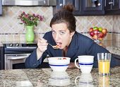 image of blue eyes  - Pretty woman in a suit eating breakfast - JPG