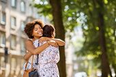 female friendship, people and leisure - young women or friends hugging at summer park poster