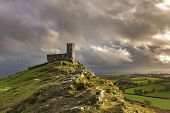 Stormy Sunset At Brentor Church With Wild Looking Sky, Devon, Uk poster
